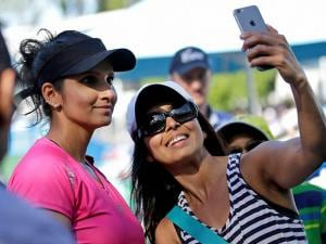 India's Sania Mirza has a picture taken with a fan