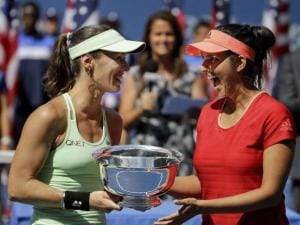 Sania Mirza, of India, and Martina Hingis, of Switzerland, celebrate