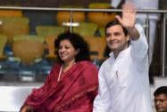 "Congress Vice President Rahul Gandhi waves as All India Mahila Congress president Sobha Ojha looks on during the ""Sankalp Diwas"" function"