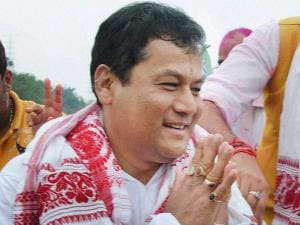 BJP chief ministerial candidate Sarbananda Sonowal greets supporters at a victory procession after the party's thumping win the Assam Assembly polls