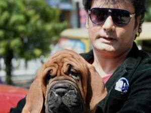 Celebrity dog breeder Satish Cadabom with a Korean dosa mastiff puppy