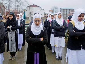 Girls take part in morning prayer in a school in Srinagar