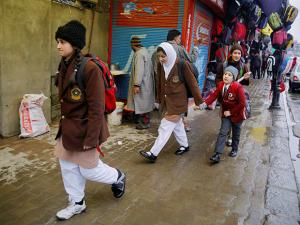 Students walking in Srinagar