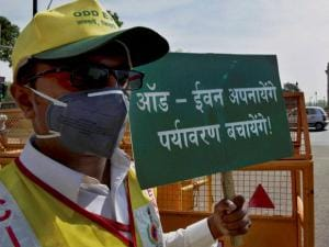 A Volunteer at a traffic signal near India Gate in New Delhi on Friday on the first day of the second phase of Delhi government's odd-even road rationing scheme.