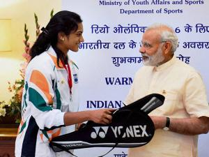 Prime Minister Narendra Modi signing the rackets of Badminton player PV Sindhu at a warm send-off ceremony