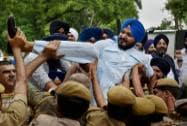 Police stop Shiromani Akali Dal-Badal activists during a protest outside AICC in New Delhi