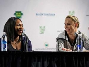 Serena Williams, left, laughs with Caroline Wozniacki during a news conference in New York