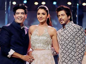 Shah Rukh Khan and Anushka Sharma along with fashion designer Manish Malhotra during the Mijwan Summer 2017