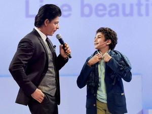 Shahrukh Khan interacts with a fan during a promotional event in Mumbai