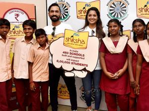 Dinesh Karthik and Dipika Pallikal At Shiksha School Students