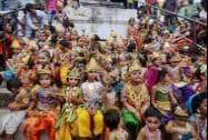 School children dressed as Gopi- Krishna take part in a competition on the eve Janmashtami