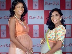 Pregnant models Carol Gracias and TV actress Shveta Salve walk the ramp on the eve of mother day