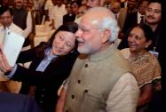 A Chinese official takes a selfie with Prime Minister Narendra Modi and Gujarat CM Anandiben