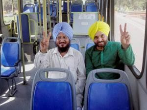 Aam Aadmi Party (AAP) MPs  Bhagwant Mann and Sadhu Singh sitting in an MP Special DTC bus at Parliament in New Delhi on Monday. Six air-conditioned special buses put in place by the Delhi