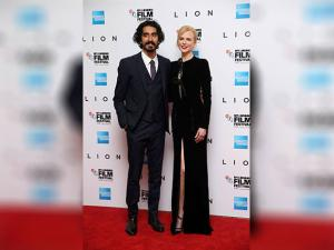 Nicole Kidman and Dev Patel pose for photographers upon arrival at the premiere of the film 'Lion'