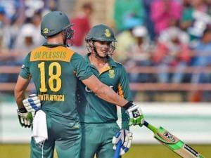 South African batsman Quinton de Kock celebrates  scoring a century
