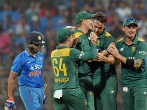 South African players celebrate Indian batsman Rohit Sharma's wicket