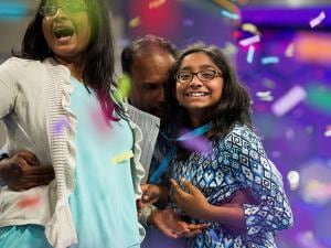 Ananya Vinay celebrates onstage with her parents Anu Pama Poliyedathpp and Vinay Sreekumar