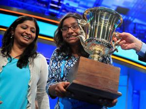 Ananya Vinay with her mother, holds her trophy
