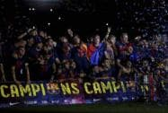 Fans cheer as FC Barcelona players ride on the team bus