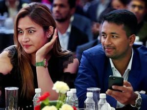 Badminton player Jwala Gutta takes selfie as cricketer Pragyan Ojha looks