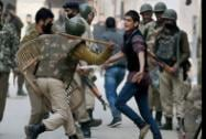 Police personnel tried to stop Muslim Shia mourners,
