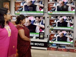People following the Union Budget 2017-18 presentation by Finance Minister Arun Jaitley, at a TV showroom in Kolkata
