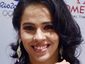 Saina Nehwal displays an Omega watch in Bengaluru