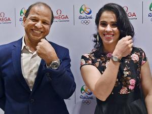 Saina Nehwal with PH Narayanan, Omega India displays a watch