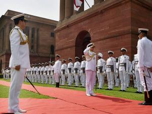 Admiral Sunil Lanba inspecting the Guard of Honour before taking over as new Indian Navy chief, at South block in New Delhi on Tuesday. Outgoing chief Robin K Dhowan