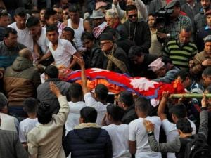 Supporters carry the body of former Nepalese prime minister Sushil Koirala, for cremation on the banks of the Bagmati River in Kathmandu