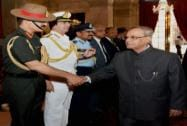 President Pranab Mukherjee shake hands with  Army Chief General Dalbir Singh Suhag as Air Chief Marshal Arup Raha, Naval Chief Admiral RK Dhowan