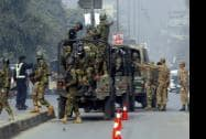Pakistani army troops arrive to conduct an operation at a school under attack by Taliban gunmen in Peshawar