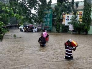 Patients and their care-takers being shifted to safe place from a flooded hospital after heavy rains in Chennai