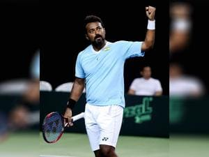 Indian tennis player Leander Paes waves to the crowd during the Davis cup  doubles match