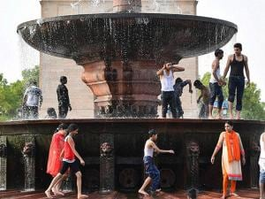 People enjoy at a fountain water at the India  as the mercury rises in New Delhi03