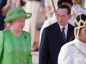 Thailand's King Bhumibol Adulyadej walks with Britain's Queen Elizabeth II