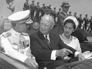 U.S. President Dwight Eisenhower, center, is seated between Thailand's King Bhumibol Adulyadej