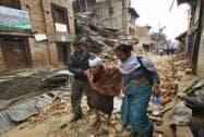 An elderly injured woman is taken to her home after treatment in Bhaktapur near Kathmandu