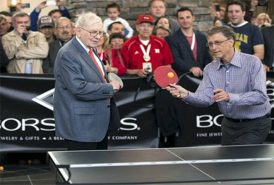 Berkshire Hathaway Chairman and CEO Warren Buffett, left, and Microsoft founder and Berkshire director Bill Gates plat table tennis during the Berkshire Hathaway shareholders meeting in Omaha