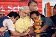 Prime Minister Narendra Modi along with Nitin Gadkari, Minister of Road Transport and Highways lighting the lamp