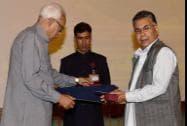 Jammu and Kashmir Governor NN Vohra presenting the State Award to folk singer Abdul Rashid Hafiz