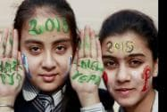 Students paint their faces as they welcome the new year 2015