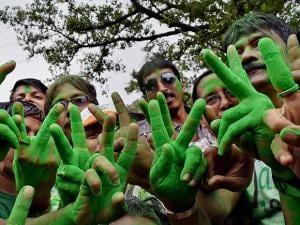 Trinamool Congress supporters make 'V' sign as they celebrate the party's thumping victory in West Bengal Assembly eections in Kolkata