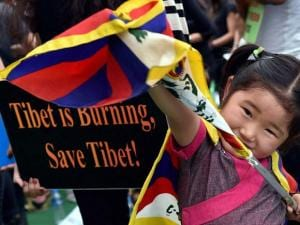 A Tibetan child takes part in an event to commemorate  the 57th Tibetan Uprising day in Bengaluru