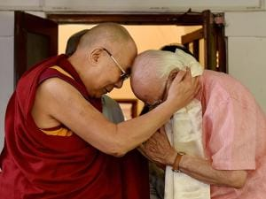BJP leader L K Advani is greeted by Tibetan spiritual leader Dalai Lama at his residence
