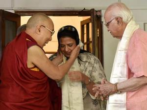 BJP leader L K Advani looks on as Tibetan spiritual leader Dalai Lama greets his daughter Pratibha