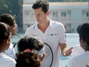 Former British tennis player Tim Henman giving tips to young tennis players at the MSLTA, in Mumbai