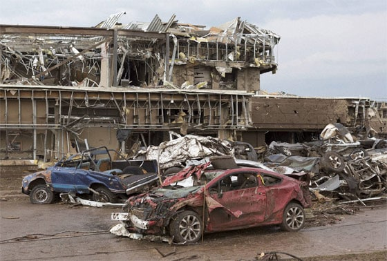 The Moore Medical Center and vehicles lay damaged after a tornado moves through Moore, Oklahoma