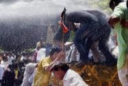 Police personnel use water cannons to disperse the BJP workers